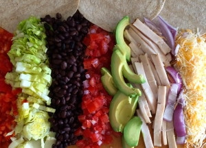 Chicken Tacos, lettuce, black beans, tomato, avocado, red onion, chicken.
