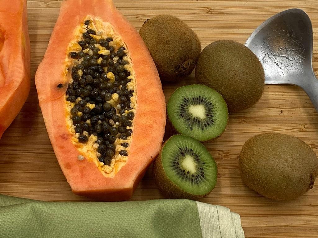 Kiwi Papaya Fruit Salad - ingredients on a cutting board