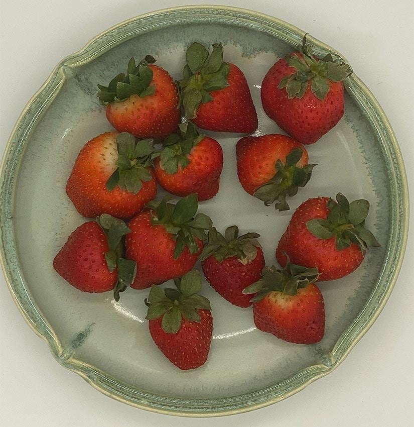 Kiwi Papaya Fruit Salad - strawberries in a bowl